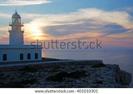 Menorca, Balearic Islands, Spain: sunset at Cap de Cavalleria lighthouse on July 8, 2013. Cap de Cavalleria lighthouse is built on a cape that was the scene of numerous shipwrecks throughout history