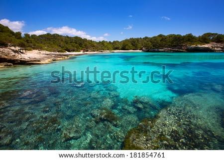 Menorca Cala en Turqueta Ciutadella turquoise Mediterranean at Balearic islands - stock photo