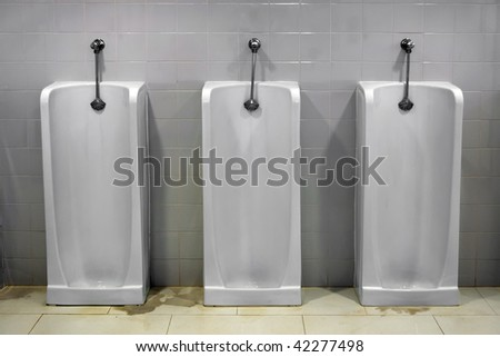Bathroom Urinal bathroom stall stock images, royalty-free images & vectors