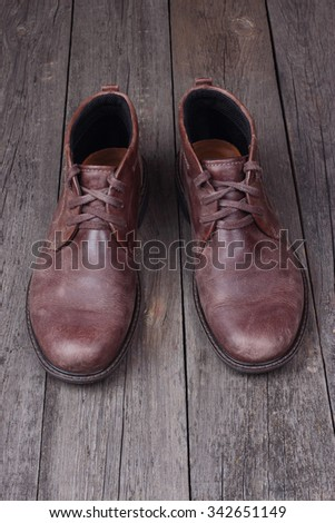 Mens brown shoes  on wooden background - stock photo