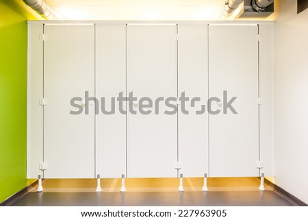 Mens restroom in an public building whit white doors - stock photo