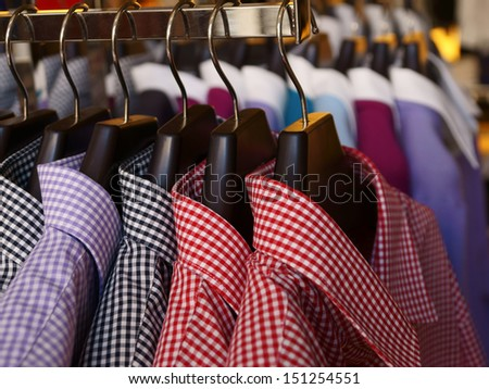 Mens shirts and jumpers in a retail store - stock photo