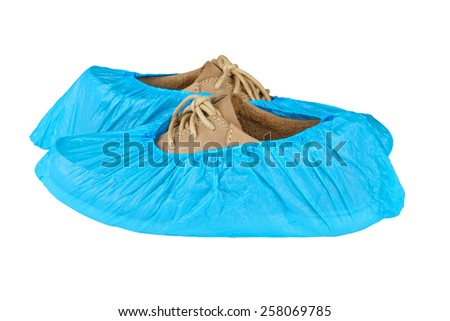 mens shoes in overshoes isolated on white background  - stock photo