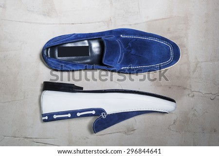 Mens Shoes on a Wooden Surface - stock photo