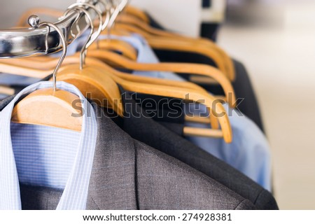 Mens suits on hangers - stock photo