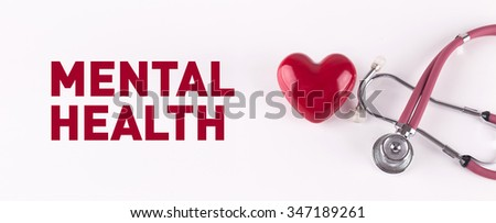 MENTAL HEALTH concept with stethoscope and heart shape - stock photo