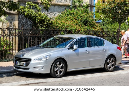 MENTON, FRANCE - AUGUST 2, 2014: Motor car Peugeot 508 at the city street.