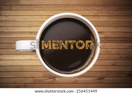mentor. coffee cup with wood background - stock photo