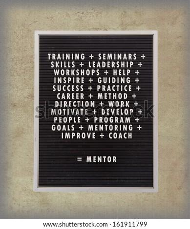 mentor concept in plastic letters on very old menu board vintage look