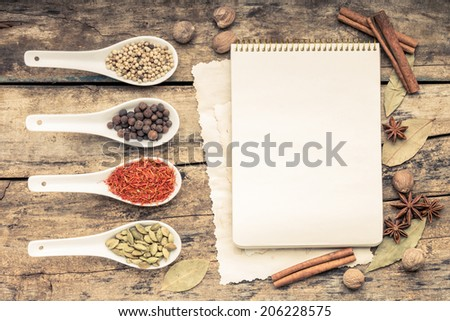 Menu background. Cook book toned image. Vintage image of recipe background. Recipe notepad with diversity of spices and herb. - stock photo