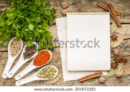 Menu background. Recipe notepad with diversity of spices and herb. - stock photo