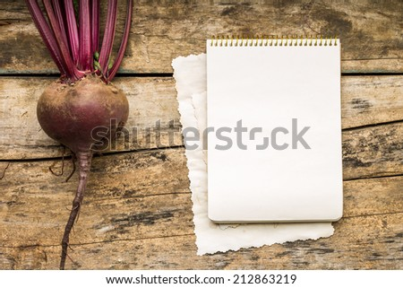 Menu background. Vegetables on table with cook book. Cooking with recipe book. Red beet - stock photo