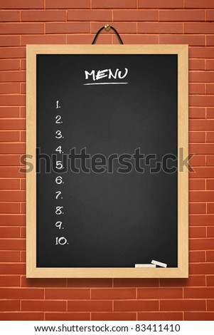 Menu black board on brown wall background