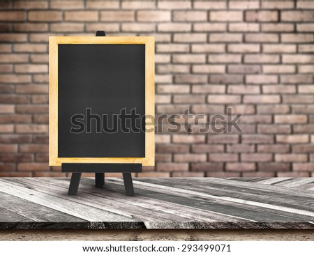 Menu blackboard on Diagonal Wooden Table top at blurred red brick wall,Template mock up for display of your product,Business presentation - stock photo