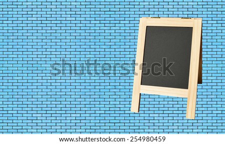 Menu blackboard on wall Blue Brick background - stock photo