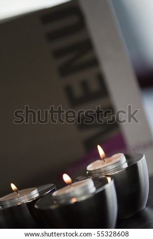 Menu card with three romantic candles. - stock photo