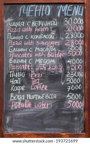 Menu in an open cafe. Letters chalk on a blackboard - stock photo