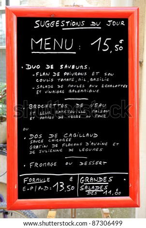Menu information outside a restaurant in France - stock photo