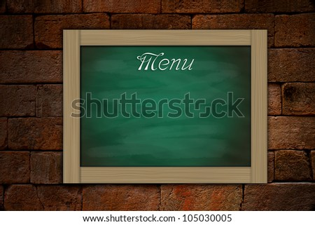 Menu on grunge green chalkboard and old brick wall background