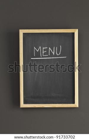Menu sketched on black board - stock photo