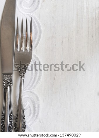 menu with silverware on the white wooden table