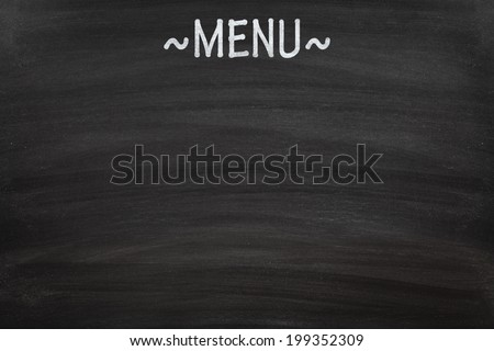 Menu written on a blank blackboard - stock photo
