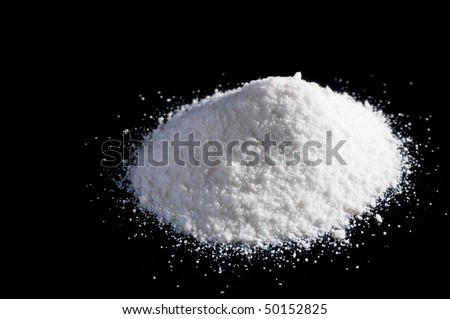 Mephedrone (aka meow, bubbles) powder on black background - stock photo
