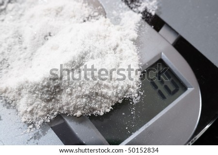 Mephedrone (aka meow, bubbles) powder on weighing scales