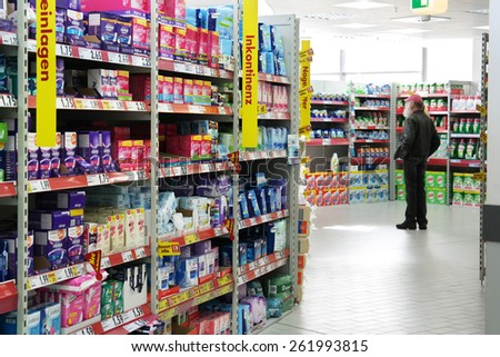 MEPPEN, GERMANY - FEBRUARY 27: Aisle with a variety feminine hygiene products in a Kaufland hypermarket, a German hypermarket chain, part of the Schwarz Gruppe. Taken in Germany, February 27, 2014 - stock photo