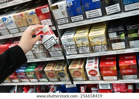 MEPPEN, GERMANY - FEBRUARY 27: Cigarette packages with the warning: smoking is lethal, in a Kaufland supermarket cigarette counter in Meppen, Germany on February 27, 2015 - stock photo