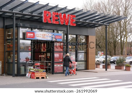 MEPPEN, GERMANY - FEBRUARY 27: Entrance of a REWE supermarket, part of the REWE Group, a German retail and tourism group, operates in 14 European countries. Taken in Meppen, Germany, February 27, 2014 - stock photo