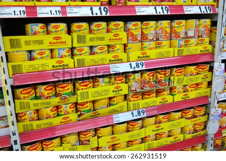 MEPPEN, GERMANY - FEBRUARY 27: Shelves filled with canned pasta from Maggi, an international food brand owned by Nestle. Photo taken in Meppen, Germany on February 27, 2014