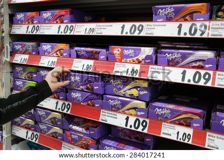 MEPPEN, GERMANY - FEBRUARY 27: Shelves with a variety of Milka chocolate bars in a Kaufland supermarket. Milka is a Swiss brand of chocolate confection. Taken on February 27, 2015 in Meppen Germany - stock photo