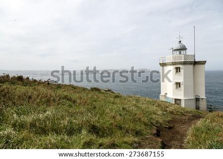 Mera lighthouse in A Coruna, galicia, Spain. View the background the city of A Coruna - stock photo