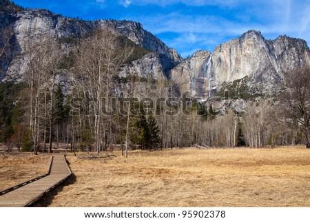 Merced meadows and Yosemite Falls in Yosemite National Park, California. - stock photo