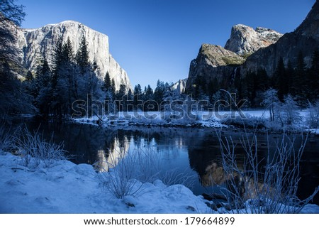 Merced River flows through Yosemite Valley in Yosemite National Park, California. This famous park is popular during all seasons of the year, including winter. - stock photo