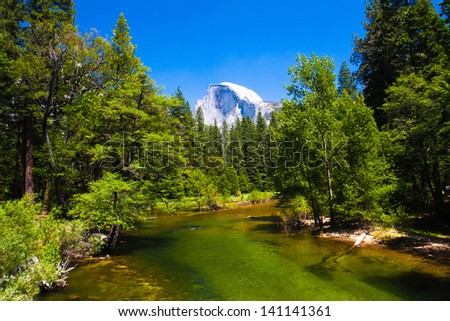 Merced River with Half Dome in background  in Yosemite National Park,California,USA - stock photo