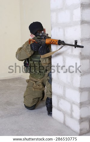 mercenary sniper with sniper rifle inside the building