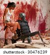 Mercenary with the submachine gun and sexy girl on the bloody wall background - stock photo
