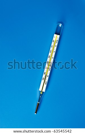 Mercury Thermometer with blue background - stock photo