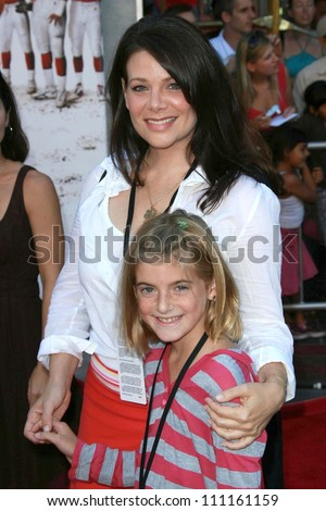 """Meredith Salenger and guest  at the world premiere of """"The Game Plan"""". El Capitan Theater, Hollywood, CA. 09-23-07 - stock photo"""