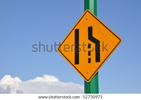 Merge right traffic sign and cloudy sky - stock photo