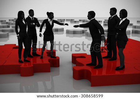 Merger of two teams on a jigsaw puzzle. Two teams of successful executives merging on a jigsaw puzzle showing a partnership. - stock photo