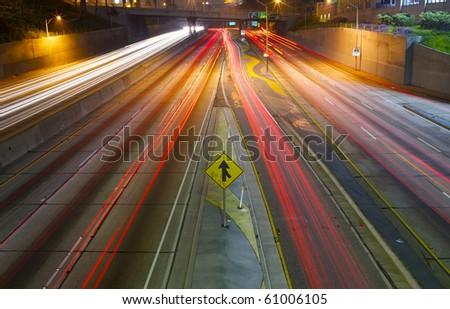 Merging Freeway traffic Time Lapse at night - stock photo
