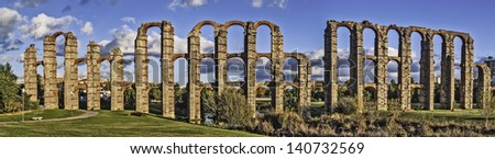 Merida, November 2012. Roman aqueduct ruins in Merida, capital of Extremadura region in Spain. I century. 830 meters. UNESCO World Heritage Site. - stock photo