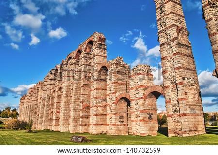 Merida, November 2012. Roman aqueduct ruins in Merida, capital of Extremadura region in Spain. I century. 830 meters. UNESCO World Heritage Site. - stock photo