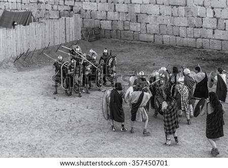 MERIDA SPAIN. September 27, 2014: Several people dressed in costumes of Roman legionaries and barbaric warriors in the first century, engaged in historical recreation. Emerita Augusta.