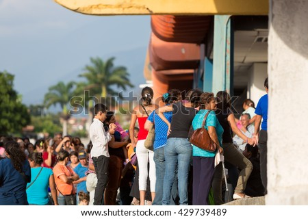MERIDA, VENEZUELA - APRIL 29: Group of people waiting in line at a public supermarket doors in Merida. With significant inflation, rationing is required in some places in Venezuela in 2015. - stock photo