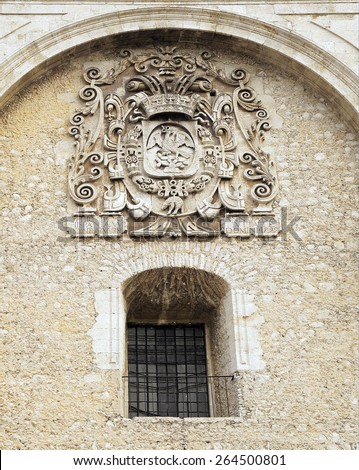 Merida, Yucatan Mexico, January 25, 2015: Detail of a window and the shield of Mexico on a historic building in Merida, Mexico. - stock photo