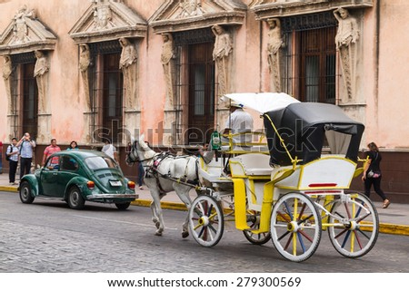 Merida, Yucatan Mexico, March 22, 2015: Horse carriages with passengers on a city street in Merida Mexico. - stock photo